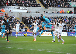 Tottenham Hotspur's Emmanuel Adebayor heads past Swansea City's Gerhard Tremmel to open the scoring - Photo mandatory by-line: Joe Meredith/JMP - Tel: Mobile: 07966 386802 19/01/2014 - SPORT - FOOTBALL - Liberty Stadium - Swansea - Swansea City v Tottenham Hotspur - Barclays Premier League