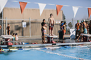 "Kern County resident Hayden Gamino, 8, waits his turn to dive during swim practice. Gamino's mother was advised by a doctor to get him in to swimming to help with his asthma. ""It feels like a wasp stinging my lungs,"" said Gamino of the asthma attacks he suffers."