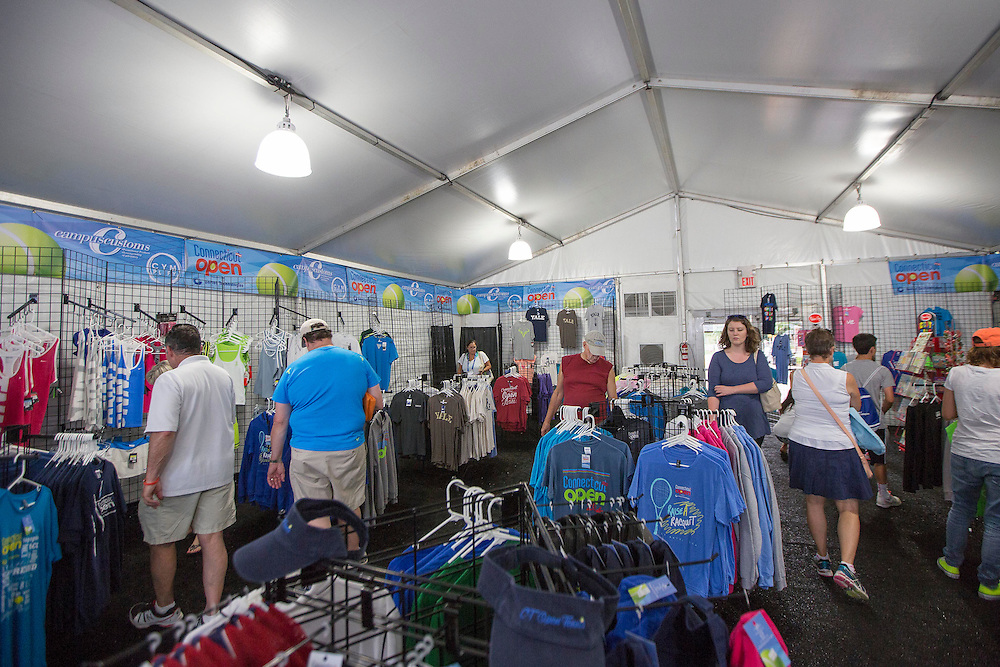 August 23, 2014, New Haven, CT:<br /> Fans shop in the Pro Shop on day nine of the 2014 Connecticut Open at the Yale University Tennis Center in New Haven, Connecticut Saturday, August 23, 2014.<br /> (Photo by Billie Weiss/Connecticut Open)