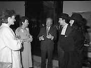 U2 Meet An Taoiseach, Charles Haughey.    (R58)..1987..18.05.1987..05.18.1987..18th May 1987..After their highly successful tour of America, An Taoiseach, Charles Haughey welcomed U2 back to Ireland with a reception held in Iveagh House, Dublin. Iveagh House formerly a home to the Guinness family is now held by the Department of Foreign Affairs...Pictured in the formal setting of Iveagh House Charles Haughey welcomes 'The Edge' (Dave Evans) back after he was part of the successful U2 tour of America. Included in the picture are Mrs Maureen Haughey,Eimear Haughey and Aishling Evans.