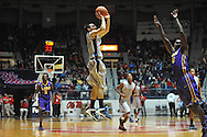 "Mississippi's Marshall Henderson (22) makes a three pointer vs. LSU's Johnny O'Bryant III (2) at the C.M. ""Tad"" Smith Coliseum in Oxford, Miss. on Wednesday, January 15, 2013. (AP Photo/Oxford Eagle, Bruce Newman)"