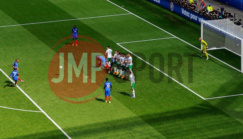 Antoine Griezmann of France fires a free kick towards goal  - Mandatory by-line: Joe Meredith/JMP - 26/06/2016 - FOOTBALL - Stade de Lyon - Lyon, France - France v Republic of Ireland - UEFA European Championship Round of 16