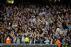 MANCHESTER, ENGLAND - Monday, April 30, 2012: Manchester City supporters celebrate their side's opening goal against Manchester United during the Premiership match at the City of Manchester Stadium. (Pic by David Rawcliffe/Propaganda)