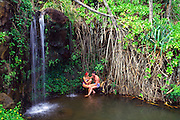 Couple at waterfall, Hanalei, Kauai, Hawaii<br />