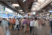 Thousands of passengers pass through Chhatrapati Shivaji Terminus railway station in Mumbai, India.
