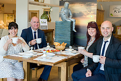 Left to Right Cake Artist Rose Dummer, Oak Furniture Land Rotherham Store Manager Jez Groom, Rotherham Hospice Fundraising Team Leader Anne Giblin and Events Fundraiser Ash Corker enjoy a Celebration Breakfast with Man of Steel at the opening of the Oak Furniture Land Rotherham Store. The cake will be donated to Rotherham Hospice who will use it to help raise funds<br /> <br /> 3 June 2015<br />  Image &copy; Paul David Drabble <br />  www.pauldaviddrabble.co.uk