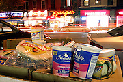 Part of the food recovered from one place only, during a Freegan trash tour to dump sites alond 3rd Avenue in Manhattan, New York, NY., on Wednesday, July 19, 2006...Freegans are a community of people who aims at recovering wasted food, books, clothing, office supplies and other items from the refuse of retail stores, frequently discarded in brand new condition. They recover goods not for profit, but to serve their own immediate needs and to share freely with others. According to a study by a USDA-commissioned study by Dr. Timothy Jones at the University of Arizona, half of all food in the United States is wasted at a cost of $100 billion dollars every year. Yet 4.4 million people in the United States alone are classified by the USDA as hungry. Global estimates place the annual rate of starvation deaths at well over 8 million. The massive waste generated in the process fills landfills and consumes land as new landfills are built. This waste stream also pollutes the environment, damages public health as landfills chemicals leak into the ground, and incinerators spew heavy metals back into the atmosphere. Freegans practice strategies for everyday living based on sharing resources, minimizing the detrimental impact of our consumption, and reducing and recovering waste and independence from the profit-driven economy. They are dismayed by the social and ecological costs of an economic model where only profit is valued, at the expense of the environment. In a society that worships competition and self-interest, Freegans advocate living ethical, free, and happy lives centred around community and the notion that a healthy society must function on interdependence. Freegans also believe that people have a right and responsibility to take back control of their time.