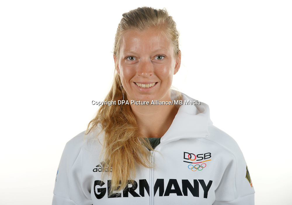 Kerstin Hartmann poses at a photocall during the preparations for the Olympic Games in Rio at the Emmich Cambrai Barracks in Hanover, Germany. July 08, 2016. Photo credit: Frank May/ picture alliance. | usage worldwide