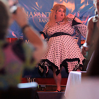 """Melanie Deas, portraying Meghan Trainor, performs """"All About That Bass"""" for Judges Jason Steele, Mrs. Mississippi Tiffany Stone and Senator Chad McMahan and packed house at Steele's Dive Tuesday night during the New Expectations for Women in Mississippi (NEWMS), a special project of the CREATE Foundation's Lip Synce Battle. The event was held as a fund aiser which assists women and children who can't be helped by other organizations."""