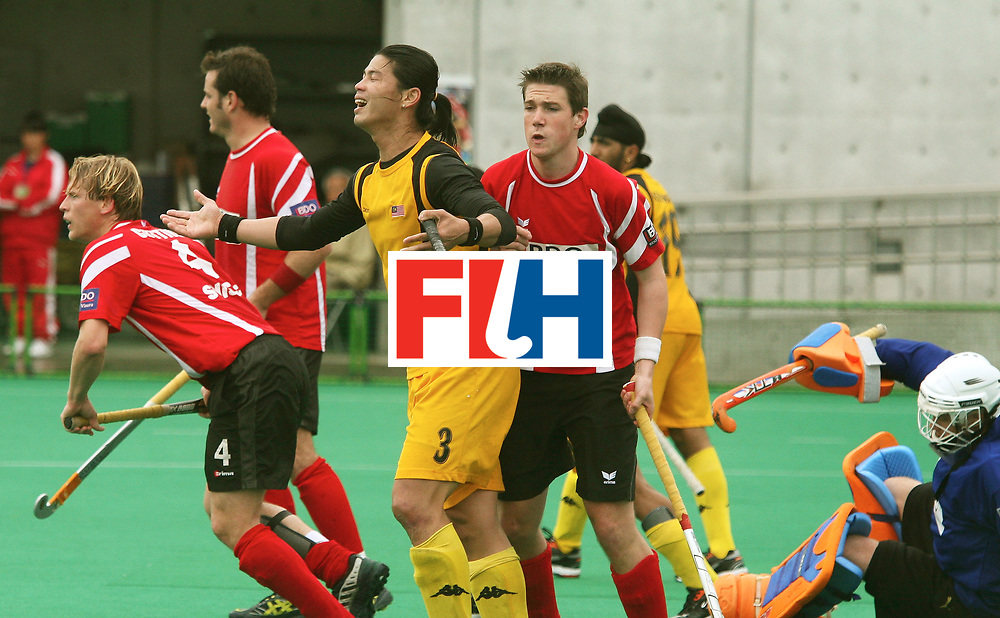 Kakamigahara (Japan): Boon Huat Chua of Malaysia feels delighted after scoring a goal beating Swiss Goal Keeper Patrick Egloff in the Olympic Hockey Qualifier at Gifu Perfectural Green Stadium at Kakamigahara on 10 April 2008. Malaysia beat Switzerland 4-3.   <br /> Photo: GNN/ Vino John