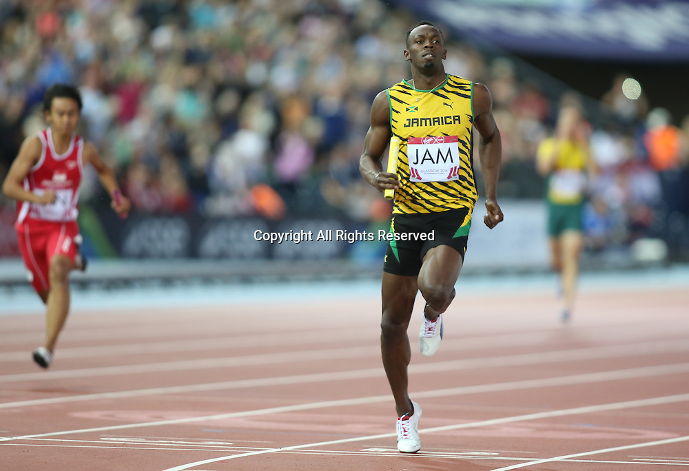 01.08.2014. Glasgow, Scotland. Glasgow Commonwealth Games. Usain Bolt runs the final leg of the men's 4 x 100m relay heat for Jamaica, finishing first and taking Jamaica through to the final.