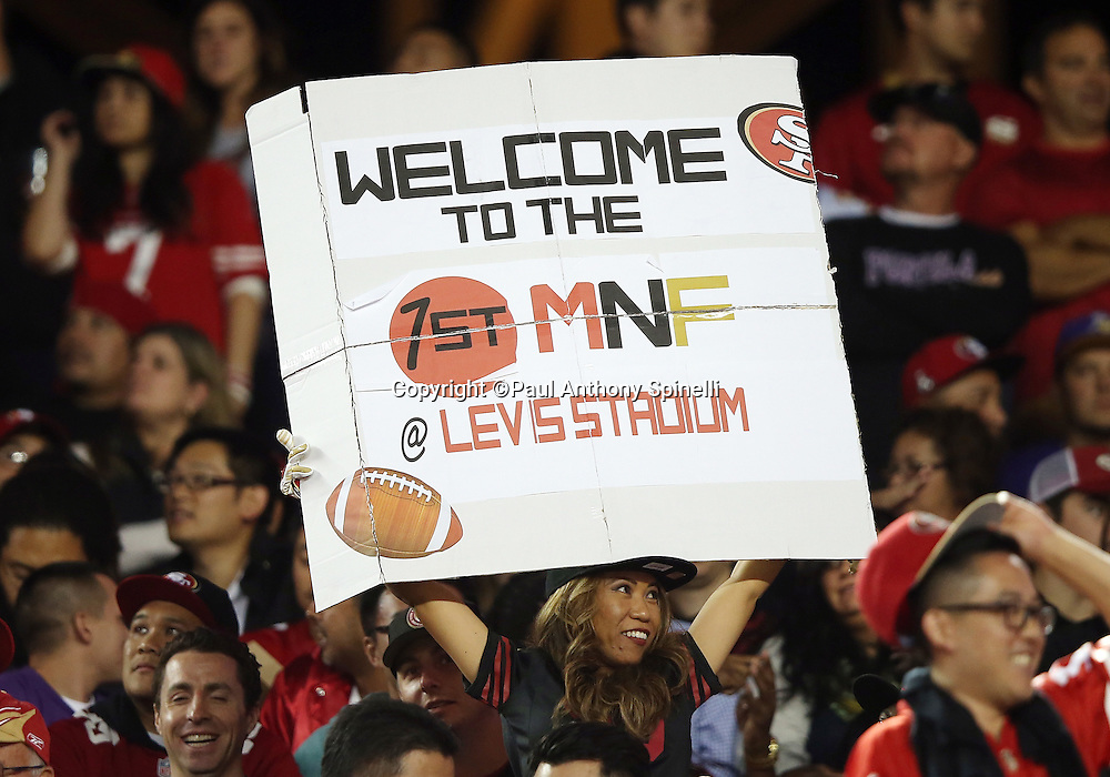 A San Francisco 49ers fan holds up a sign welcoming Monday Night Football to Levi's Stadium for the first time during the San Francisco 49ers 2015 NFL week 1 regular season football game against the Minnesota Vikings on Monday, Sept. 14, 2015 in Santa Clara, Calif. The 49ers won the game 20-3. (©Paul Anthony Spinelli)