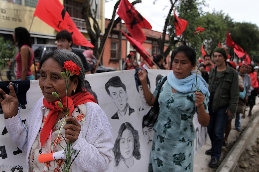 Members of Guatemalan human rights and anti-militarization organizations march during the 2011 March for Remembrance, a counter-protest march to the official Armed Forces Holiday. Progressive groups have argued that the annual June 30th military demonstration, cancelled since 2008, added insult to injury to the thousands of victims of Guatemala's 36-year civil war. Guatemala City, Guatemala. June 30, 2011.