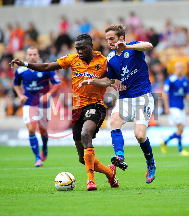 Wolverhampton Wanderers Tongo Hamed Doumbua battles for the ball with Leicester City's Andy King - Photo mandatory by-line: Joe Meredith/Josephmeredith.com  - Tel: Mobile:07966 386802 16/09/2012 - Wolves v Leicester City - SPORT - FOOTBALL - Championship -  Wolverhampton  -  Molineux Stadium  -