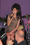 07.OCTOBER.2010. LONDON<br /> <br /> AMY WINEHOUSE PERFORMING ON STAGE FIRST BY HERSELF AND THEN WATCHES DAD MITCH SING, BEFORE GETTING ON STAGE WITH MITCH AND DOING A DUET WITH HIM AT NEW CLUB CITY BERLESQUE IN FARINGDON.<br /> <br /> BYLINE: EDBIMAGEARCHIVE.COM<br /> <br /> *THIS IMAGE IS STRICTLY FOR UK NEWSPAPERS AND MAGAZINES ONLY*<br /> *FOR WORLD WIDE SALES AND WEB USE PLEASE CONTACT EDBIMAGEARCHIVE - 0208 954 5968*