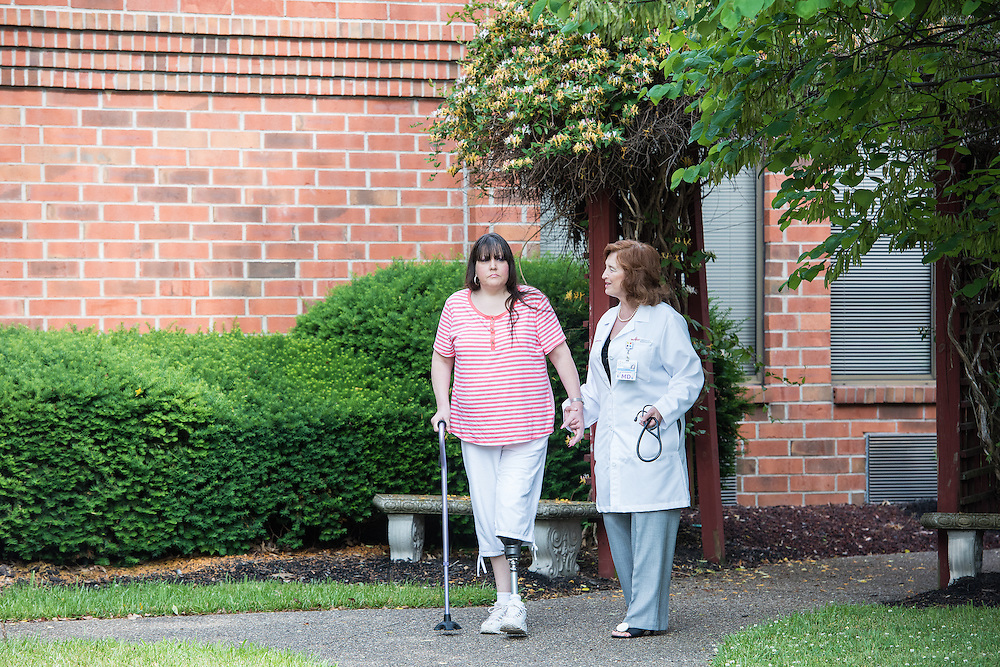 Hospitalist Madonna Ringswald, DO, FAAIM, photographed with patient Rhonda Carmen,  Wednesday, May 27, 2015 at Baptist Health in LaGrange, Ky. (Photo by Brian Bohannon/Videobred for Baptist Health)