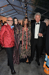 Left to right, ERIC BUTERBAUGH, DEMI MOORE and COUNT LEOPOLD & COUNTESS DEBONAIRE VON BISMARCK at British Vogue's Centenary Gala Dinner in Kensington Gardens, London on 23rd May 2016.