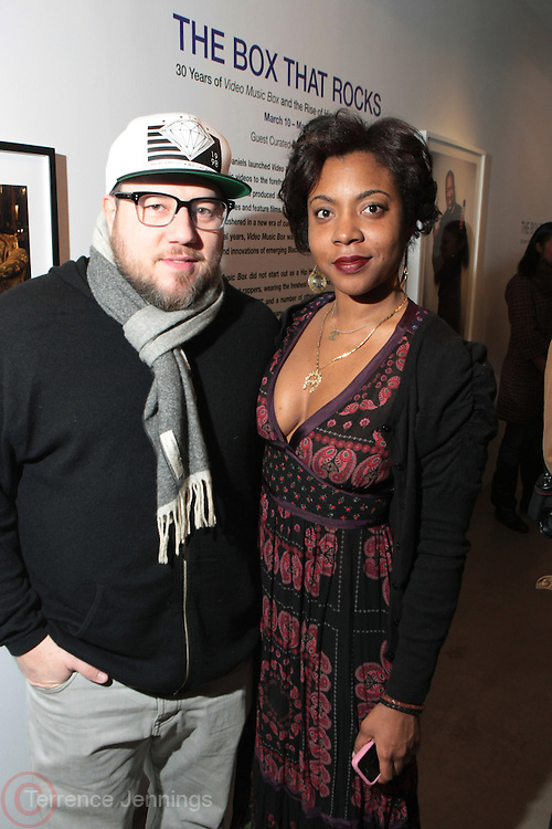 New York, NY- MARCH 10: (L-R) Photographer Jonathan Mannion and Stark Magazine CEO, Amy Andrieux at the Opening Reception of ' THE BOX THAT ROCKS: 30 Years of Video Music Box and the Rise of Hip Hop Music & Culture held at the Museum of Contemporary African Diasporan Arts (MoCADA) on March 10, 2012 in Brooklyn, New York City. (Photo by Terrence Jennings)