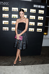 AMBER LE BON at the SportMax + Cutler & Gross launch party hosted by Leigh Lezark at The Arts Club, 40 Dover Street, London on 23rd October 2013.