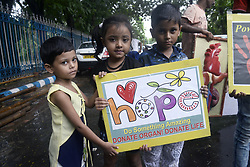 July 27, 2017 - Kolkata, West Bengal, India - Children holds awareness poster during the organ donation awareness program in Kolkata. Members of Health and Welfare Society participate in an awareness program on ''After Death Organ Donation' (Credit Image: © Saikat Paul/Pacific Press via ZUMA Wire)