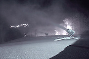 With the lights from the slopes of neighboring Nubs Nob in the distance some of Boyne Highlands new low energy snow guns run through the night to get ready for the opening of the coming ski season.