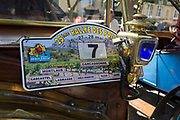 Detail of a badge and lamp from a visiting vintage car in the centre of a French village, during a three-day rally journey through the Corbieres wine region, on 26th May, 2017, in Lagrasse, Languedoc-Rousillon, south of France. Lagrasse is listed as one of France's most beautiful villages and lies on the famous Route 20 wine route in the Basses-Corbieres region dating to the 13th century.