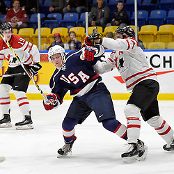 WHITBY, - Dec 18, 2015 -  Game #12 - Bronze Medal Game, Team Canada East vs. United States at the 2015 World Junior A Challenge at the Iroquois Park Recreation Complex, ON.  Max Zimmer #6 of Team United States tries to get past Adam Smith #5 of Team Canada East during the first period.<br /> (Photo: Shawn Muir / OJHL Images)
