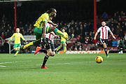 Norwich City striker Cameron Jerome (10) with a shot during the EFL Sky Bet Championship match between Brentford and Norwich City at Griffin Park, London, England on 31 December 2016. Photo by Matthew Redman.