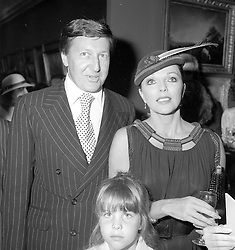 JOAN COLLINS & RON KASS at a Charity Auction in aid of Save The Children at Sotheby's New Bond Street London on 18th June 1979.