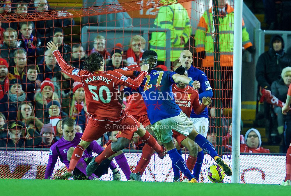 LIVERPOOL, ENGLAND - Thursday, New Year's Day, January 1, 2015: Liverpool's Lazar Markovic blocks a shot from Leicester City's Marcin Wasilewski during the Premier League match at Anfield. (Pic by David Rawcliffe/Propaganda)