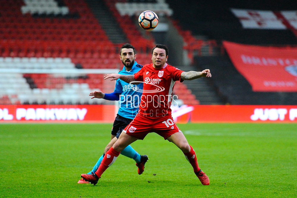 Lee Tomlin (10) of Bristol City battles for possession with Conor McLaughlin (2) of Fleetwood Town during the The FA Cup match between Bristol City and Fleetwood Town at Ashton Gate, Bristol, England on 7 January 2017. Photo by Graham Hunt.