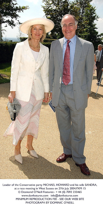 Leader of the Conservative party MICHAEL HOWARD and his wife SANDRA, at a race meeting in West Sussex on 27th July 2004.PXM 15