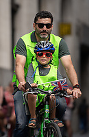 Young rider in the City of London. Prudential RideLondon FreeCycle. Saturday 28th July 2018<br /> <br /> Photo: Thomas Lovelock for Prudential RideLondon<br /> <br /> Prudential RideLondon is the world's greatest festival of cycling, involving 100,000+ cyclists - from Olympic champions to a free family fun ride - riding in events over closed roads in London and Surrey over the weekend of 28th and 29th July 2018<br /> <br /> See www.PrudentialRideLondon.co.uk for more.<br /> <br /> For further information: media@londonmarathonevents.co.uk
