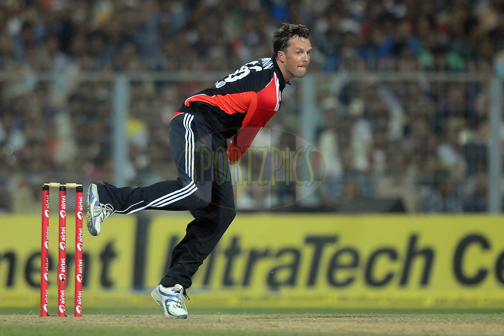 Graeme Swann of England bowls during the T20 International match between India and England held at the Eden Gardens Stadium, Kolkata on the 29th October 2011..Photo by Pal Pillai/BCCI/SPORTZPICS