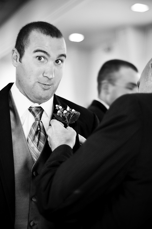 Matt's groomsmen get their boutineers get pinned on