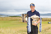 Scottish Open winner 2011. Luke Donald with the winners bottle of Ballantine's 30 year old and the winner's trophy.
