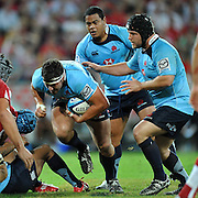 """Al Baxter charges forwards for the Waratahs during action from the Super 15 Rugby Union match played between the Queensland Reds and the NSW Waratahs at Suncorp Stadium (Brisbane, Australia) on Saturday 23rd April 2011<br /> <br /> Conditions of Use : NO AGENTS ~ This image is intended for Editorial use only (news or commentary, print or electronic) - Required Images Credit """"Steven Hight - Aura Images"""""""