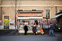ROME, ITALY - 7 January 2014: Two women buy meat at the open-air market in Via del Pigneto, a two block-long pedestrian zone in the Pigneto neighborhood of Rome, Italy, on February 7th 2014.