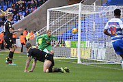 Bolton Wanderers goalkeeper Ben Amos watches the ball slide past his post during the Sky Bet Championship match between Reading and Bolton Wanderers at the Madejski Stadium, Reading, England on 21 November 2015. Photo by Mark Davies.