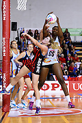Queensland player Romelda Aiken and Tactix player Zoe Walker compete for the ball during their ANZ Championship Netball game between the Mainland Tactix v Queenland Firebirds. Marlborough Lines Stadium 2000, Blenheim, New Zealand. Sunday 24 May 2015. Copyright Photo: Chris Symes / www.photosport.co.nz
