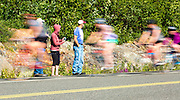 Racers ride past supporters on the highway during the 2016 Kluane Chilkat International Bike Relay.