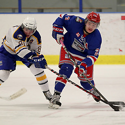 Buffalo, NY - Feb 4 : Ontario Junior Hockey League game action between the Buffalo Junior Sabres and the Oakville Blades, Nolan Sheeran #81 of the Buffalo Junior Sabres Hockey Club tries to block a pass by Greg Campbell #23 of the Oakville Blades Hockey Club during third period game action. (Photo By Timothy T. Ludwig / OHJL Images)