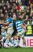Twickenham, United Kingdom. George KRIUS, gets a tough on Pablo CUBELLI'S clearance kick to deflect the ball, during the Old Mutual Wealth Series Rest Match: England vs Argentina, at the RFU Stadium, Twickenham, England, <br /> <br /> Saturday  26/11/2016<br /> <br /> [Mandatory Credit; Peter Spurrier/Intersport-images]