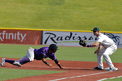 28 May 2017: Aaron Dudley waits for a pick off throw as the Crusher base runner dives safely back to the bag during a Frontier League Baseball game between the Lake Erie Crushers and the Normal CornBelters at Corn Crib Stadium on the campus of Heartland Community College in Normal Illinois