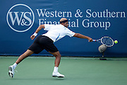 CINCINNATI, OH - AUGUST 18: James Blake of the United States returns a shot to Igor Kunitsyn of Russia during day two of the Western & Southern Financial Group Masters on August 18, 2009 at the Lindner Family Tennis Center in Cincinnati, Ohio. Kunitsyn defeated Blake 7-6, 6-7, 6-4. (Photo by Joe Robbins)