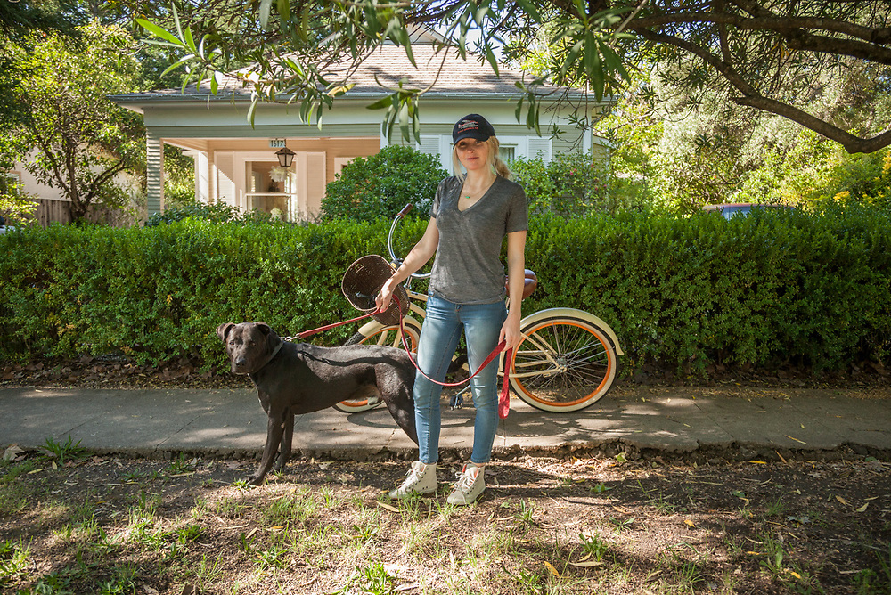 Paralegal Vanessa Cooper with her dog, Zeus, on Cedar Street in Calistoga