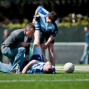April 18, 2010 - Bronx, NY : Sean McGrath, a Manhattan College student and member of the New York Gaelic Athletic Association's Dublin squad, is on hand to aid a fallen teammate. Dublin versus Astoria Gaels on April 18.
