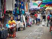 11 OCTOBER 2016 - UBUD, BALI, INDONESIA:  Jalan (Street) Gootama, one of the main tourist shopping streets next to the market in Ubud. The morning market in Ubud is for produce and meat and serves local people from about 4:30 AM until about 7:30 AM. As the morning progresses the local vendors pack up and leave and vendors selling tourist curios move in. By about 8:30 AM the market is mostly a tourist market selling curios to tourists. Ubud is Bali's art and cultural center.     PHOTO BY JACK KURTZ