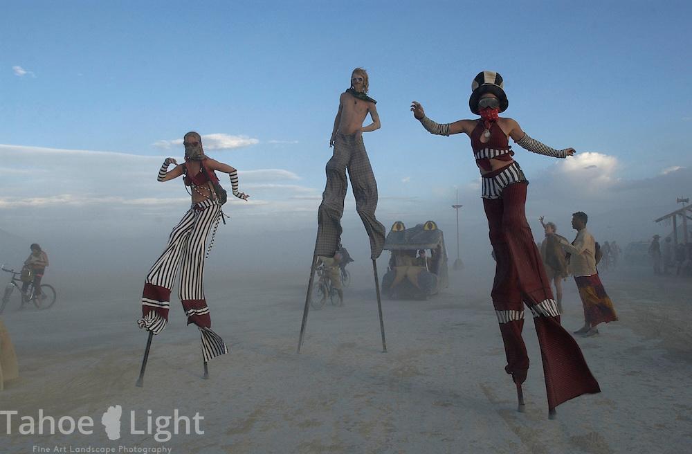 Stilt walkers enjoy a sunset stroll at the Burningman counter culture arts festival in the Black Rock Desert 100 miles north east of Reno, NV, Thursday, Sept 2, 2004.