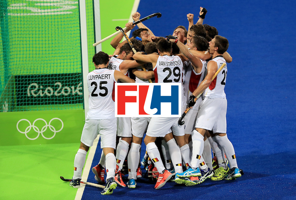 RIO DE JANEIRO, BRAZIL - AUGUST 16:  Members of the Belgium hockey team celebrate following a 3-1 semifinal victory over the Netherlands on Day 11 of the Rio 2016 Olympic Games at the Olympic Hockey Centre on August 16, 2016 in Rio de Janeiro, Brazil.  (Photo by Sam Greenwood/Getty Images)
